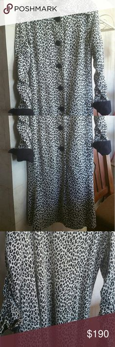 """Vintage leopard coat sweater newport news 10 Size 10 NEW PORT NEWS. This has been in storage & never used, perfectly preserved, & so very lovely & chic! Always wanted to wear it ! & never had the """"place""""My life is boring! This coat hangs & flounces at the bottom, for a flowing femine look, with very large bottons giving it such a retro look farther back than its day. This is soft smooth feeling & m thick, warm for cool autumn nights. This one was a toss up to list.  It has stretch also. NO…"""