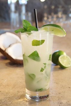 Coconut Mojito    (Squeeze of half a lime    6 mint leaves    1 oz. Ciroc Coconut Vodka    .5 oz. coconut rum    1 oz. pineapple juice    .25 oz. cream of coconut    Splash of soda    Sprig of mint and lime wedge for garnish) by MEJUDY KING