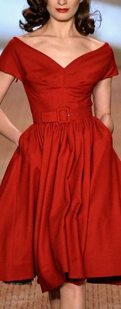 vintage style red silk off the shoulder dress with full skirt.  belt at waist.
