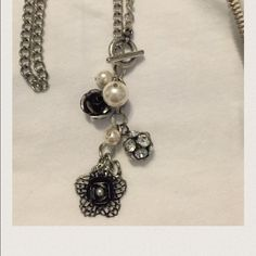 """Collection of bobbles on a toggle chain . Fun necklace to throw on with anything. It is a toggle chain in silver and the bobbles are in an antique black and silver with a rhinestone ball and some pearls. It hangs approx 17"""". Jewelry Necklaces"""