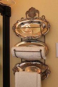 Towel rack with silver platters.  Unexpected.