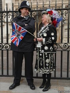 Wedding of Prince William and Catherine - A traditional London pearly queen chats to a policeman and shows there is more than one type of royalty present.