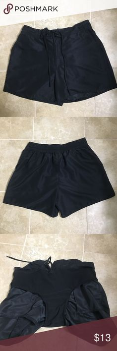 Black board shorts Great pair of women's swim shorts. Front has two pockets. Also has a zipper, button, and tie to tighten. AND has built in bikini! I turned them inside out in one of the pictures to show. 😊 Catalina Swim