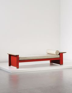 JEAN PROUVÉ Rare 'Cité' bed, model no. 10, designed for the Cité Universitaire, Nancy, 1932 Painted bent steel, oak, fabric. 62.3 x 237 x 84.7 cm (24 1/2 x 93 1/4 x 33 3/8 in.) Manufactured by Les Ateliers Jean Prouvé, France.