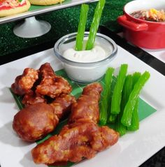 "These faux buffalo wings are made entirely out of Kellogg's Rice Krispie Treats.  I covered them in a brown sugar and tangerine glaze.  The ""bleu cheese"" is actually marshmallow sauce with bits of marshmallow and the ""celery"" is green licorice!"