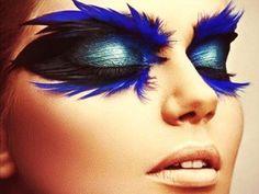 Dramatic blue feathered eye makeup: