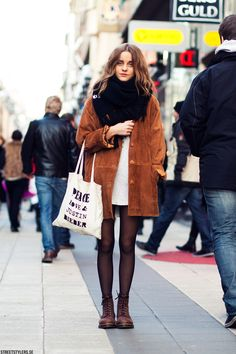 Black tights, brown suede jacket and messy hair.