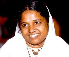 """""""A real yogi is one who can maintain a peaceful mind in the midst of any crisis."""" —Amma"""