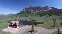Once in a lifetime does a property such as this become available. The end-of-the-road location is only a few miles to downtown Crested Butte. From the endless views to the tranquil setting of the grounds, you will be mesmerized by this offering. The spring-fed pond, loaded with mature trout adding to the majestic beauty, is only steps from either dwelling. The main house with its cabin-like feel compliments the tremendous views of the surrounding mountains. The separate guest quarters…