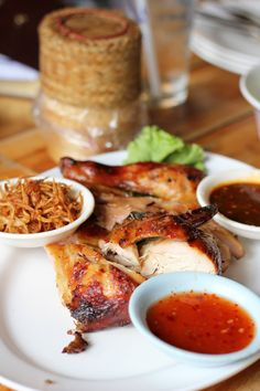 Nothing better than grilled chicken, sticky rice (in basket) and dipping sauces