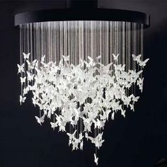 Butterfly chandelier (diy butterfly origami instructions at the source)
