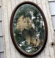 Make a spooky mirror. Get an old mirror with a frame. Remove the backing. With heavy gloves, spray some oven cleaner on the back, wait about 5 minutes, rub off. Now just tape a spooky picture. Put backing back on. Voila! Scary face looking back at you.