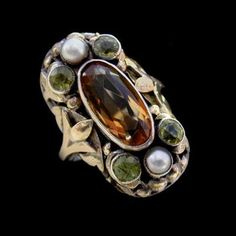 arts crafts ring | Bernard Instone. Arts and Crafts ring. Silver, gold, citrine, peridot ...