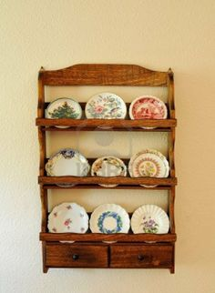 Antique Miniature Butter Pat Plates On An Old Wooden Shelf Hanging.. Royalty Free Stock Photo, Pictures, Images And Stock Photography. Image 6814144.