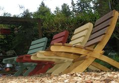 Colorful outdoor folding chairs made form reclaimed cedar decking boards