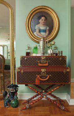 A lone big-boy turquoise foo dog in a home designed by Elizabeth Bauer Designs