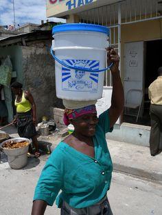 Woman carrying water in #Haiti