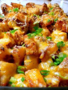 RANCH ROASTED POTATOES    2 pounds potatoes (unpeeled, washed and cut into chunks)  ½ cup ranch dressing (bottled, not packet)  ¼ cup shredded cheddar cheese, plus more for topping (if desired)  ¼ cup crumbled, cooked bacon  1 tablespoon all purpose dill mix  3 scallions, washed and chopped  Salt and pepper to taste