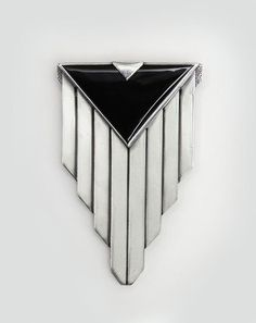 "PENDANT by Jean Després (1889-1980) France, circa 1929 Length: 3"" - Width: 2"" Silver and onyx pendant in a cubist design with a triangle of black onyx above eight silver panels. Later transformed into a brooch. Hallmarks: 950 silver/ signed J. Despres"