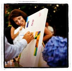 A custom-painting from your guests~ I love love love this idea! Esp. because C is such an artist! This particular couple assigned a friend to help guests paint a part of a large canvas. What a perfect memory to take with you and a wonderful piece of decor for your home. <3 {C, you could even use the art easel from L?} ;)