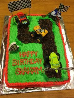 Blaze and the monster machines cake with buttercream icing, crumbled cookies & toy monster trucks