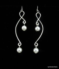 Earrings with Pearls on Sculpted Wire by byBrendaElaine on Etsy