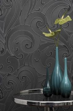 textured wallpaper...I think this would be cool on the bottom half of the walls in my bathroom...love the charcoal/pewter color.