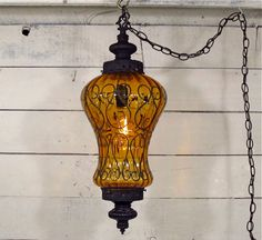 1960s Decorated Amber Glass Swag Lamp with Black Wrought Iron Finials Light Fixture