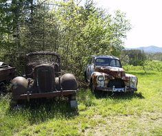 "Old Abandoned 1930's Truck and old abandoned Super Deluxe Car (1940-42 vintage) in field beside US-52-N, just across the Virginia line on way to Hillside, Virginia. All emblems were lost except ""Super Deluxe"" model designation on the car, so I cannot identify the make or model year."