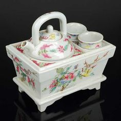 Chinese Famille Rose Porcelain Teapot. Qianlong Mark. Chinese tea set w/ tea pot & 2 cups and porcelain box to hold everything.