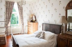 "Traditional Bedroom by Amelia Hallsworth Photography. Houzz.co.uk. Exploring Architecture: Discover the Secrets of Edwardian Homes. ""Floral wallpaper and light walls Art Nouveau, which embraced floral designs and motifs, would also come to influence wallpaper designs in Edwardian homes, although they would feature more muted patterns, such as the soft florals in this bedroom."""