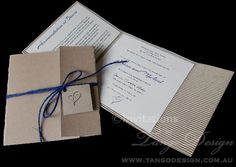 country wedding invitations with blue cord with heart tag in natural #corrugated card #country wedding invitations
