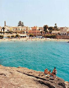 Italy has finessed the art of blending town and beach. At Santa Maria al Bagno, in Puglia, there is a subtle social theater directing who goes where, with the trendier crowd preferring the rocks.