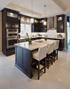 There is no question that designing a new kitchen layout for a large kitchen is much easier than for a small kitchen. A large kitchen provides a designer with adequate space to incorporate many convenient kitchen accessories such as wall ovens, raised. Cozy Kitchen, Home Decor Kitchen, Interior Design Kitchen, Kitchen Furniture, New Kitchen, Home Kitchens, Kitchen Ideas, Kitchen White, Furniture Stores