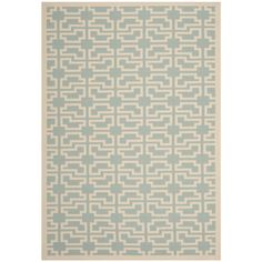 Safavieh's Courtyard collection is inspired by timeless designs crafted with the softest polyproplene available. This rug is crafted using a power-loomed construction with a pile and features main accent color of blue.