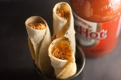 Baked Buffalo Chicken Taquitos - these would be good cut up (after baking) for appetizers at a party