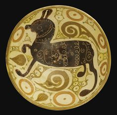 A Nishapur pottery Bowl with a quadruped, Eastern Persia, 10th century of deep circular form, the earthenware body decorated in orange, brown, and purple-black slip on a cream ground under a transparent glaze, featuring a stylised quadruped amidst dotted and scrolled motifs, the exterior plain with a band of circular outlines    23.7cm. diam.  9.3cm. height.
