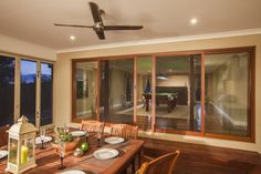 Getting ready for some summer entertaining with Amplimesh SupaScreen Folding Doors and Double Sliding Doors at dusk.