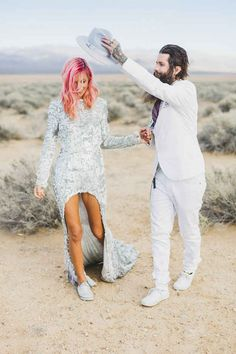 Beautiful super fun untraditional hipster hippie bohemian Las Vegas wedding photography | silver studded wedding dress front cut, pink ombre hair, white tux suit, bearded men