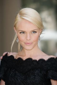 The beautiful Kate Bosworth with the perfect ice blond hair color, light make-up and black dress.