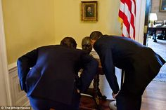 Close up: During a 2010 visit to the White House, Obama shows then-Prime Minister David Ca...
