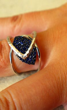 hammered ring has heart made of sapphires.