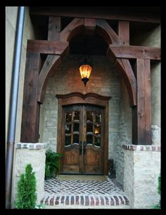 Rich wood tones in the entryway and doors make a spectacular presentation! Would love a house that matches these doors!