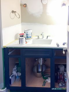 Tips and trick on how to paint thermofoil cabinets (or even laminate) to make it adhere! Step-by-step instructions to getting beautiful painted cabinets! Painting Laminate Kitchen Cabinets, Melamine Cabinets, Mdf Cabinets, Painting Cabinets, Life On Virginia Street, Paint Line, Delta Faucets, Drawer Fronts, Cabinet Doors