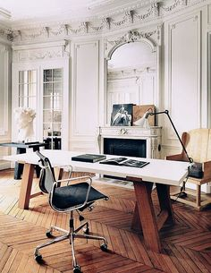 Nice juxtaposition of traditional details with a classic managers chair and massive industrial desk.