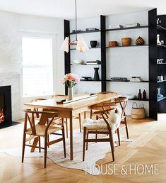 Black wraparound steel shelves create a graphic focal point inarchitect Darcie Watson's Scandi-inspired dining room. | Design: Darcie Watson | Photo: Naomi Findlay