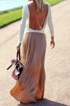 Love the open back with a long necklace and flowing skirt.