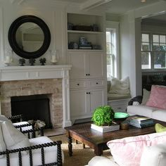 Brick around fireplace, trim detail and I like the design of the built-ins on each side.