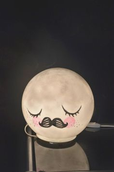 Turn the old Ikea light into a mustachioed moon