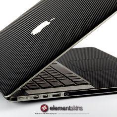 "Black Carbon Fibre Full Wrap Skin Kit for MacBook Pro (15"") with Retina Display. $49.95, via Etsy."